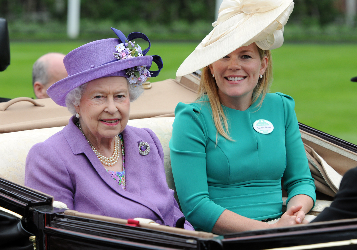 Queen Elizabeth II and Autumn Phillips attend Ladies Day on Day 3 of Royal Ascot at Ascot Racecourse on June 20, 2013 in Asco