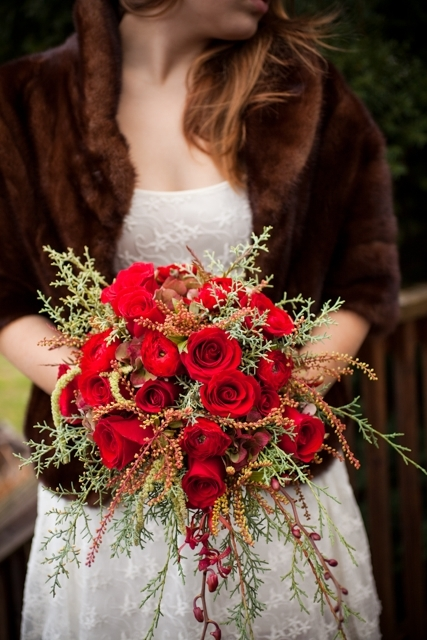 "Red roses add a glam touch at a rustic winter wedding.  <a href=""http://lover.ly/explore?q=winter+wedding+decor&utm_sourc"