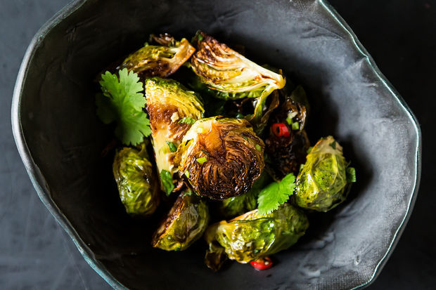 """<strong>Get <a href=""""http://food52.com/recipes/19682-momofuku-s-roasted-brussels-sprouts-with-fish-sauce-vinaigrette"""" target="""