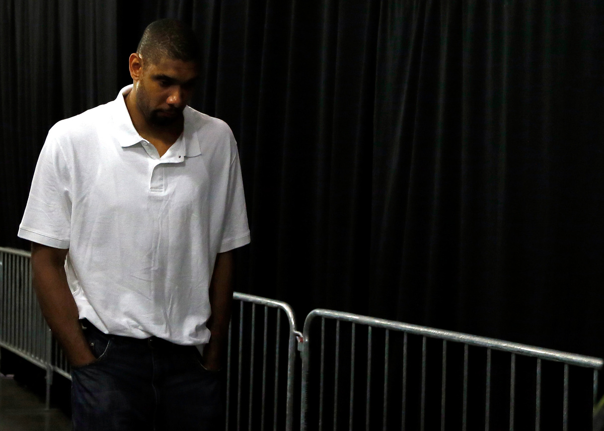 MIAMI, FL - JUNE 20:  Tim Duncan #21 of the San Antonio Spurs walks through the tunnel towards the exit after losing to the M