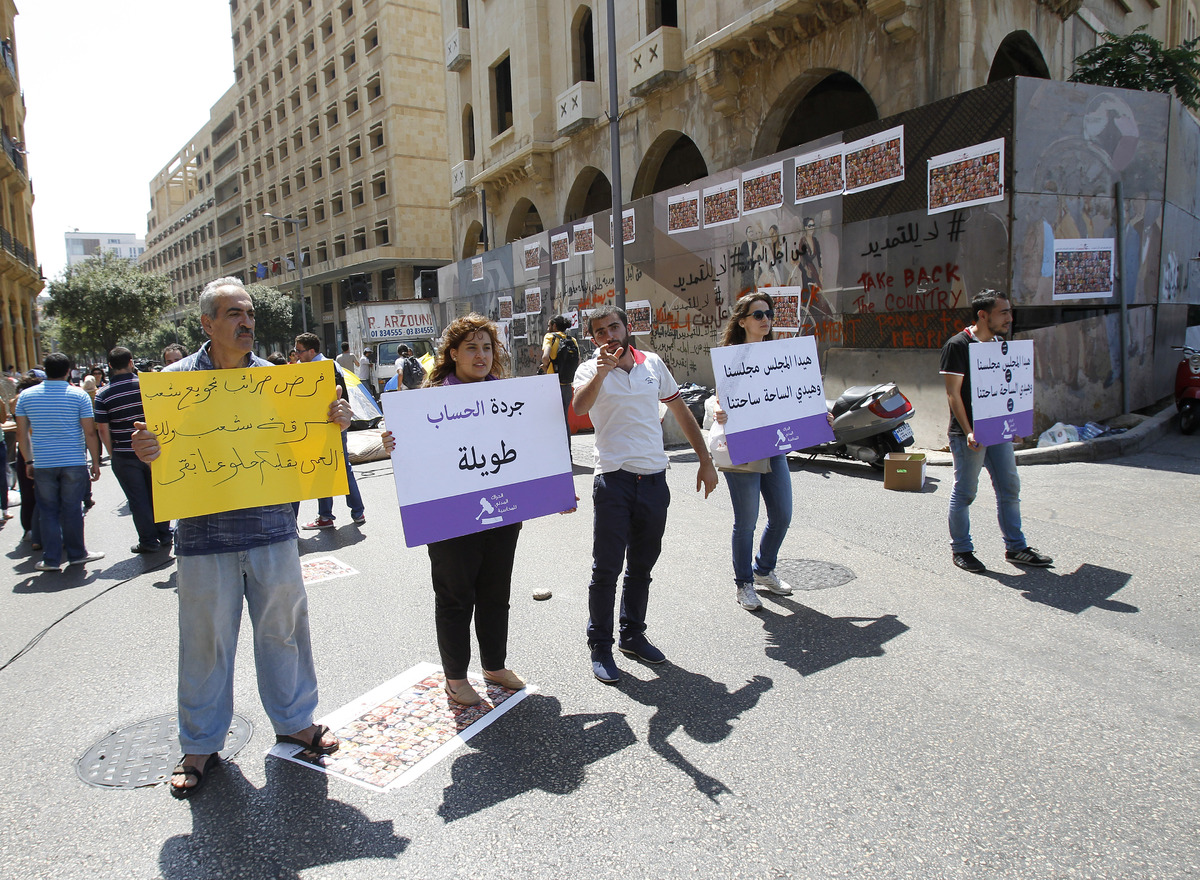 Lebanese demonstrators gather during a protest in downtown Beirut on June 21, 2013, against the extension of the mandate of t