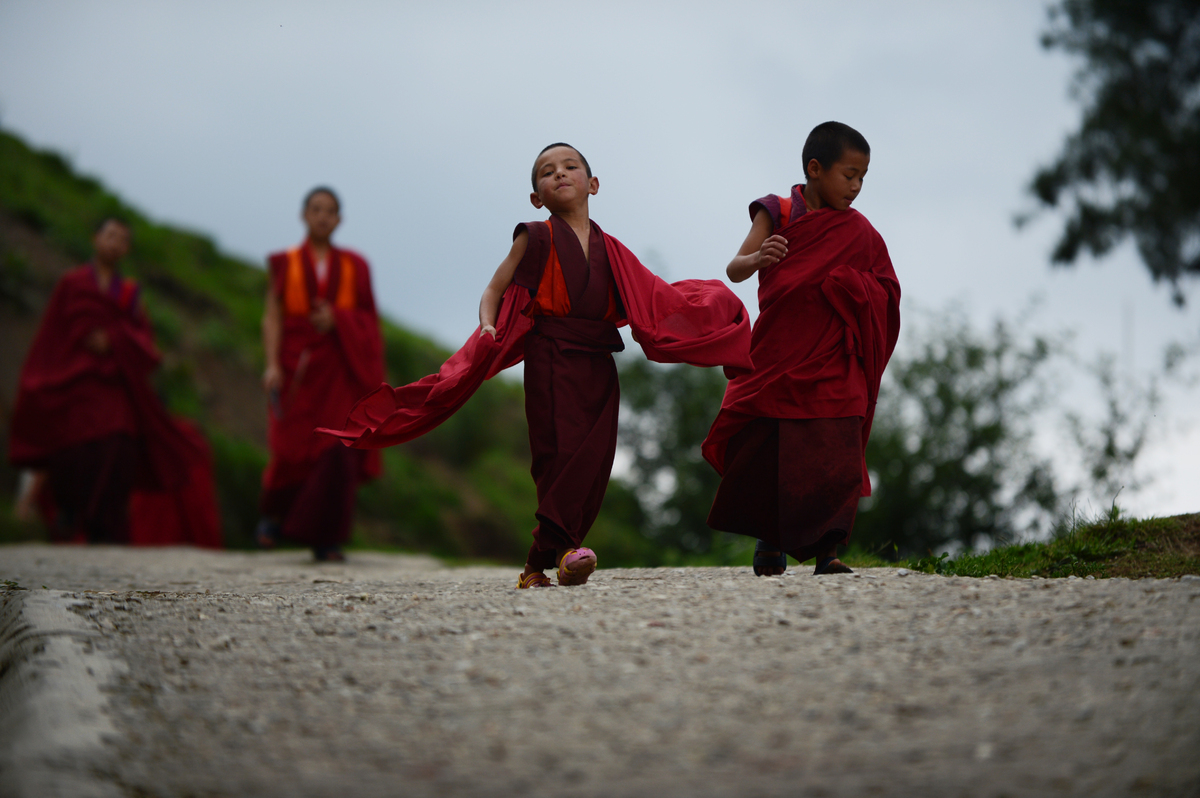This image is part of of a photo package on children going to school around the world and it shows six-year-old monk apprenti