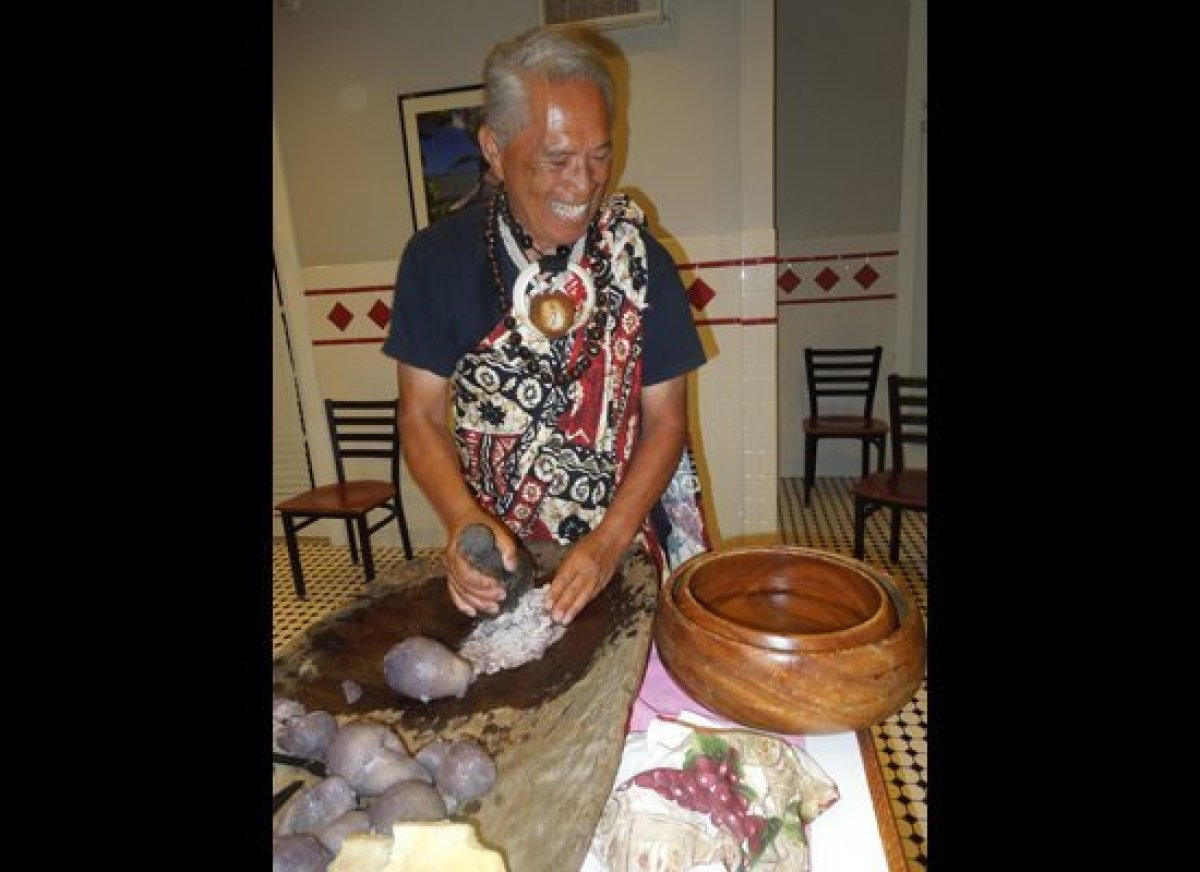 Respected Hawaiian elder and storyteller Anakala Pilipo Solatorio demonstrates the finer points of making poi during a demons