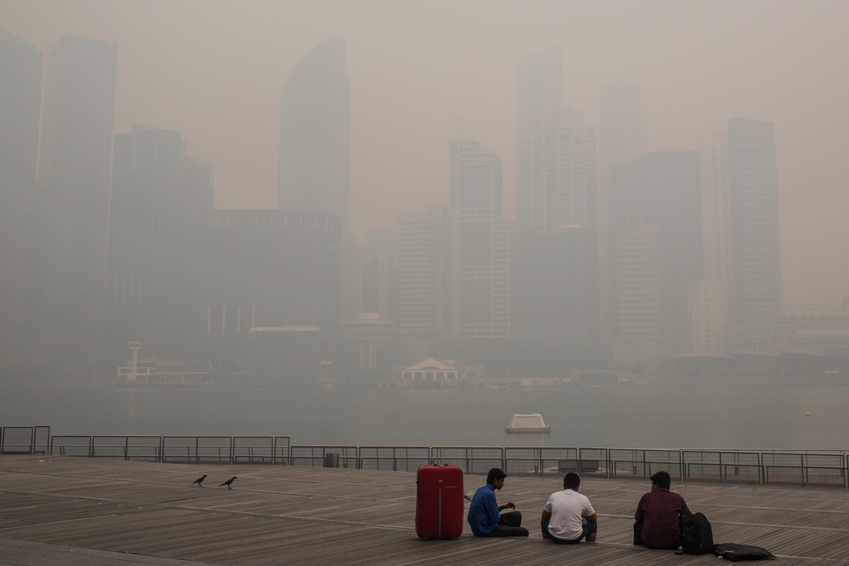 The Singapore skyline is nearly completely covered in smoke haze on June 21, 2013 in Singapore. The Pollutant Standards Index