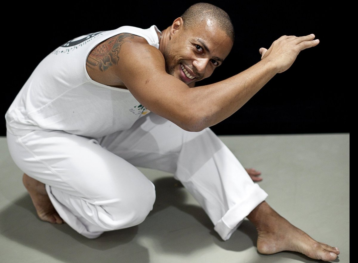 "Mestre Lampreia of Motumbaxé Capoeira in a ""Negativa"", which is both a transitional position from one move to another, and a"