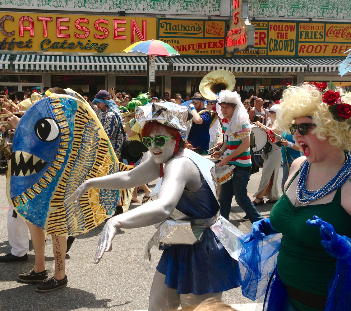 In this photo provided by Natascha Yogachandra, revelers take part in the 2013 Coney Island Mermaid Parade in the Brooklyn bo