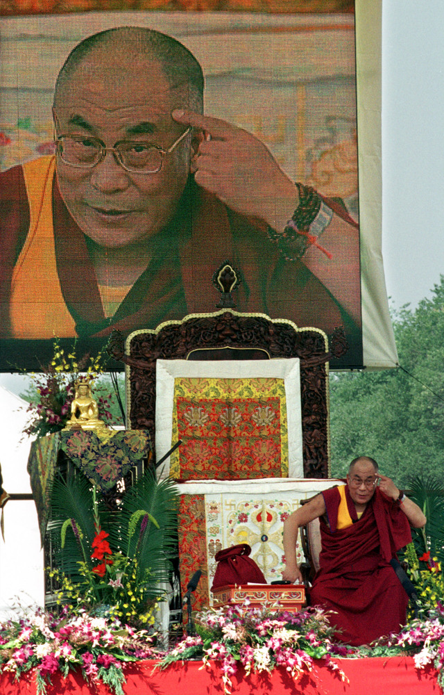 The Dalai Lama speaks July 2, 2000 during the Smithsonian Folklife Festival on the National Mall in Washington. Approximately