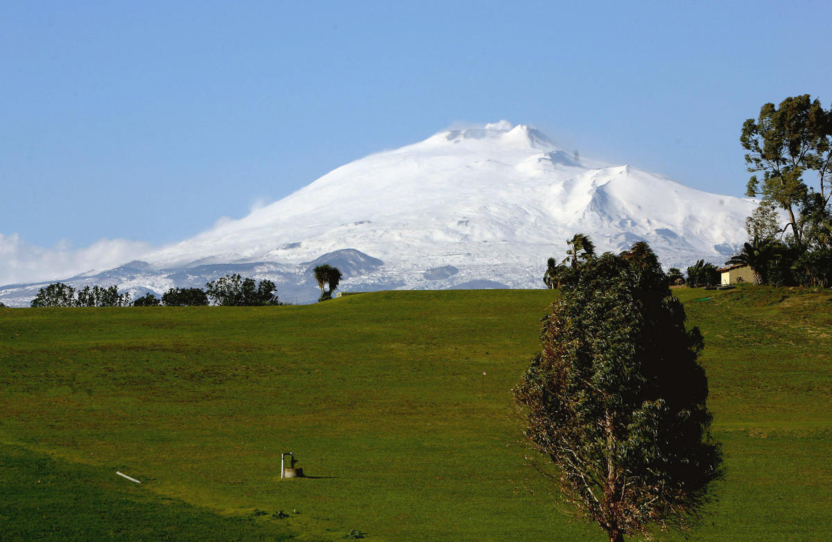 The sicilian Mount Etna volcano is pictured 08 March 2006 after a night snowfall. (FABRIZIO VILLA/AFP/Getty Images)