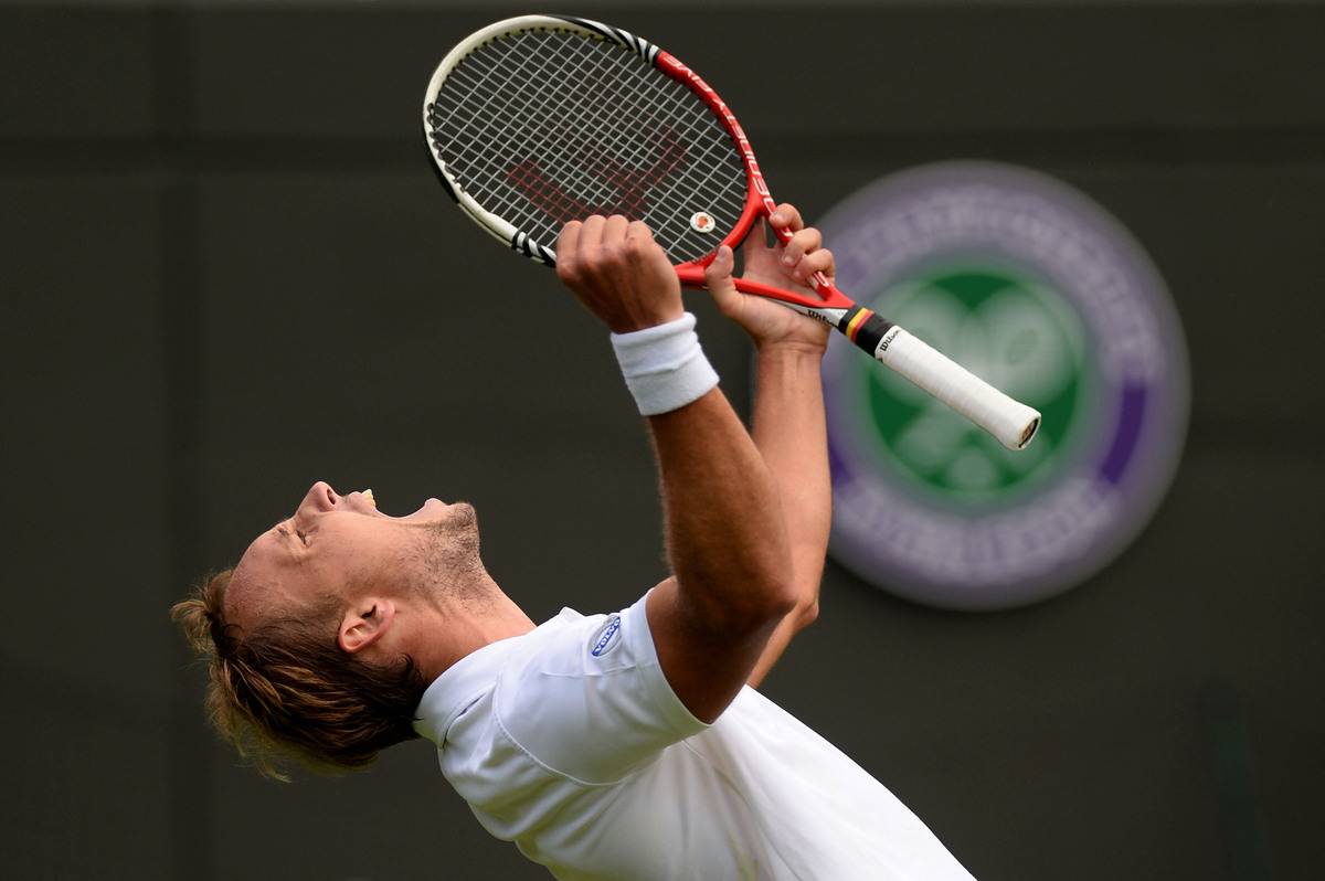 LONDON, ENGLAND - JUNE 24:  Steve Darcis of Belgium celebrates match point during his Gentlemen's Singles first round match a