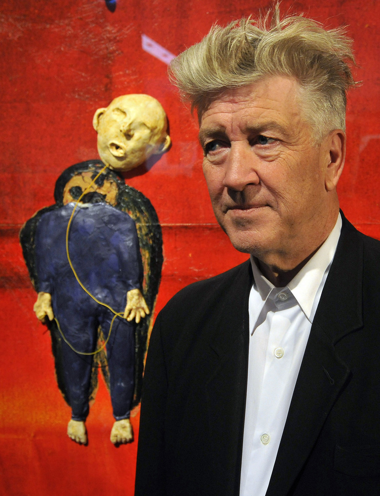 US director David Lynch poses for photographers at an exhibition of his work in the western German city of Breuhl near Cologn