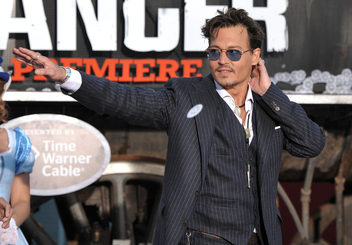 "Johnny Depp appears on stage at the world premiere of ""The Lone Ranger"" at Disney California Adventure on Saturday, June 22,"