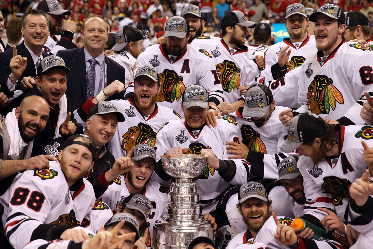 The Chicago Blackhawks celebrate their 2-1 victory over the Boston Bruins in Game Six of the 2013 NHL Stanley Cup Final at TD