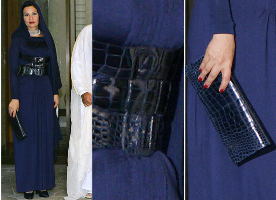 Belted up in navy blue with a matching snake skin clutch while visiting Tokyo.