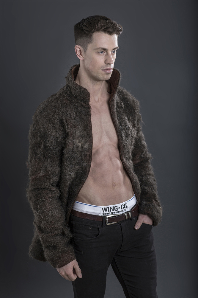 Man-Fur Coat: A male model is pictured wearing the world's first fur coat made from 100% male chest hair. The coat was commis
