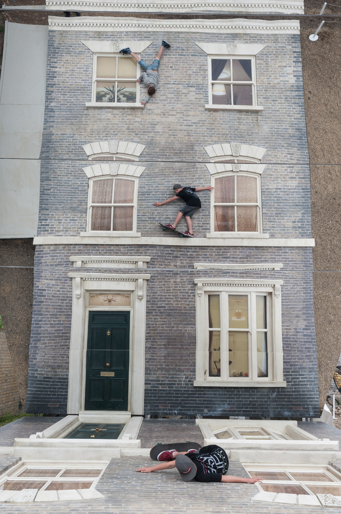 """Visitors play with illusion Leandro Erlich: Dalston House Installation images © Gar Powell-Evans 2013 Courtesy of <a href=""""ht"""