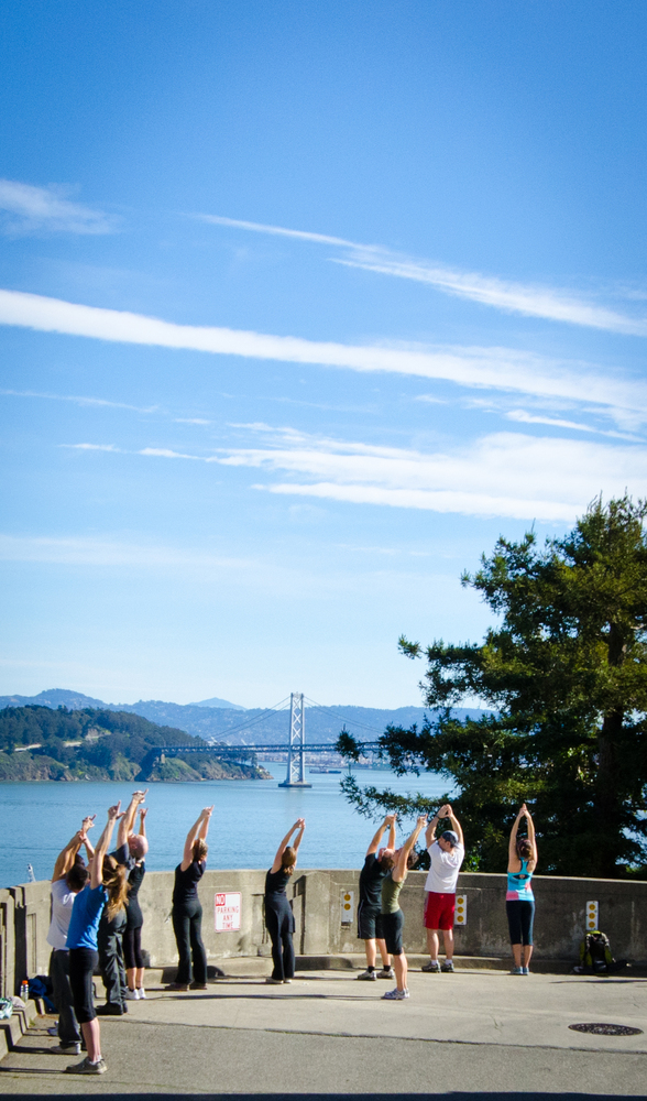 Sneaker-clad certified yogis will guide you briskly through parks and along trails, pausing to lead you through basic yoga po