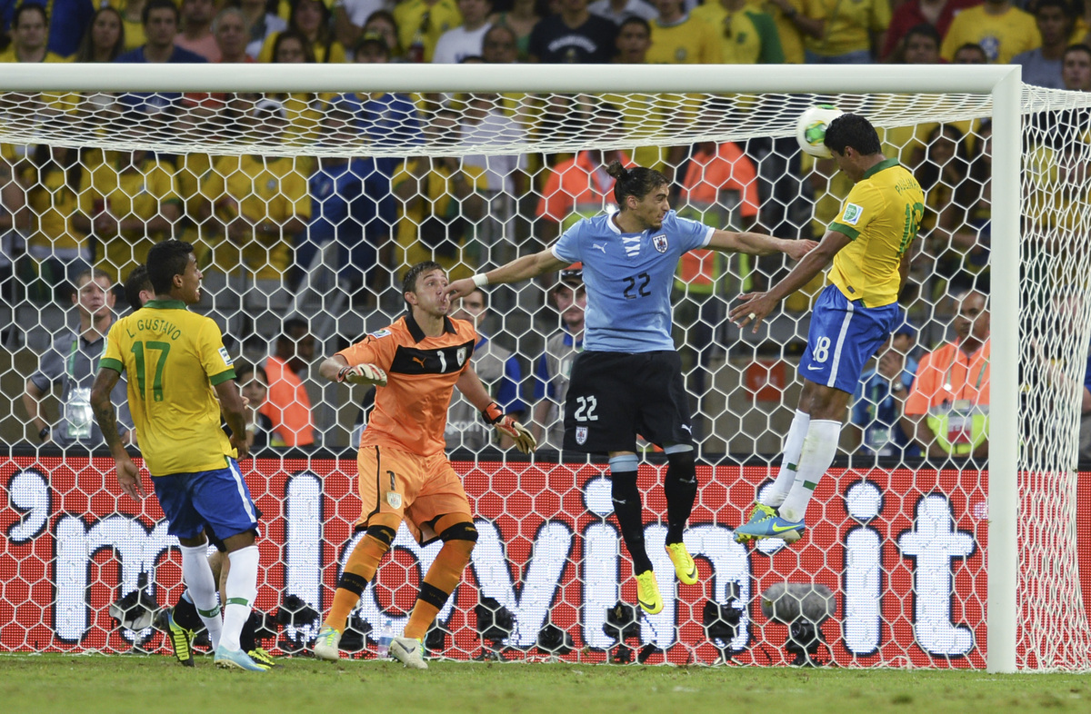 Brazil's Paulinho, right, scores his side's 2nd goal during the soccer Confederations Cup semifinal match between Brazil and
