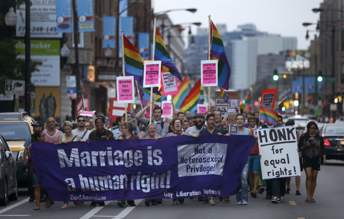 Supporters of gay rights march up Clark Avenue near Wrigley Field following a rally in the Boystown neighborhood of Chicago,