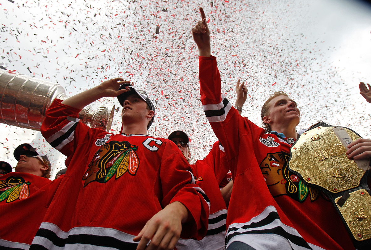 Jonathan Toews #19 (L) and Patrick Kane #88 celebrated with the crowd during the Chicago Blackhawks Stanley Cup victory parad
