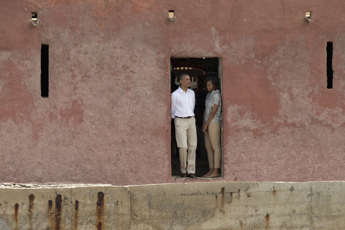U.S. President Barack Obama and first lady Michelle Obama stand together in the 'Door of No Return,' at the slave house on Go