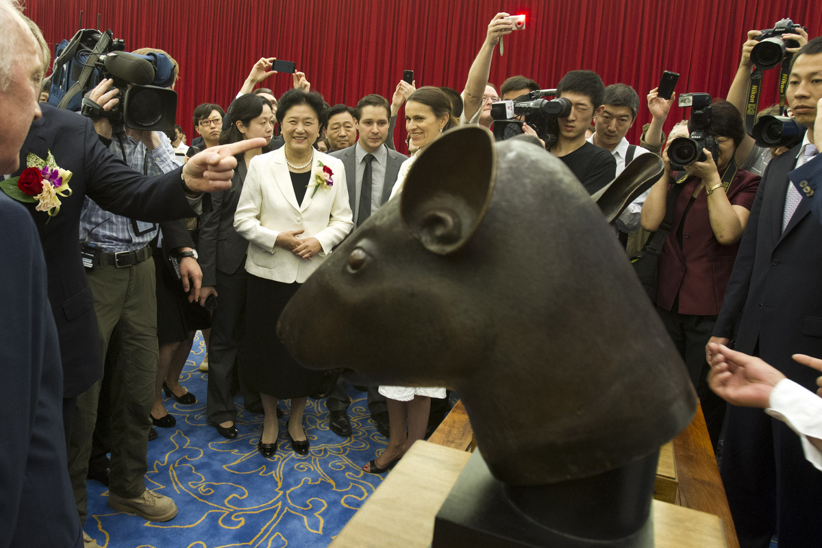 Chinese Vice Premier Liu Yandong, center in white, attends a ceremony to unveil a pair of Qing dynasty bronzes that were loot