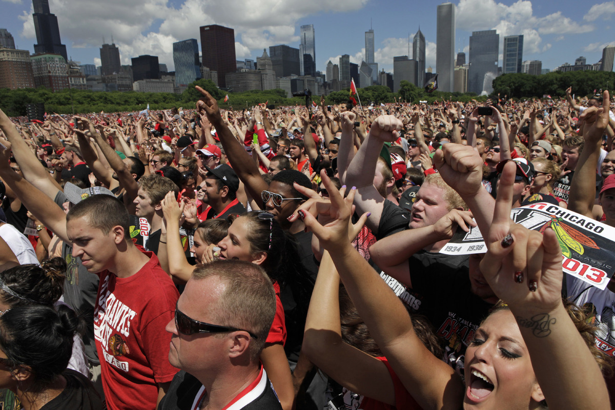 Fans cheer in Grant Park for a rally to honor the Stanley Cup hockey champions Friday, June 28, 2013, in Chicago. (AP Photo/K