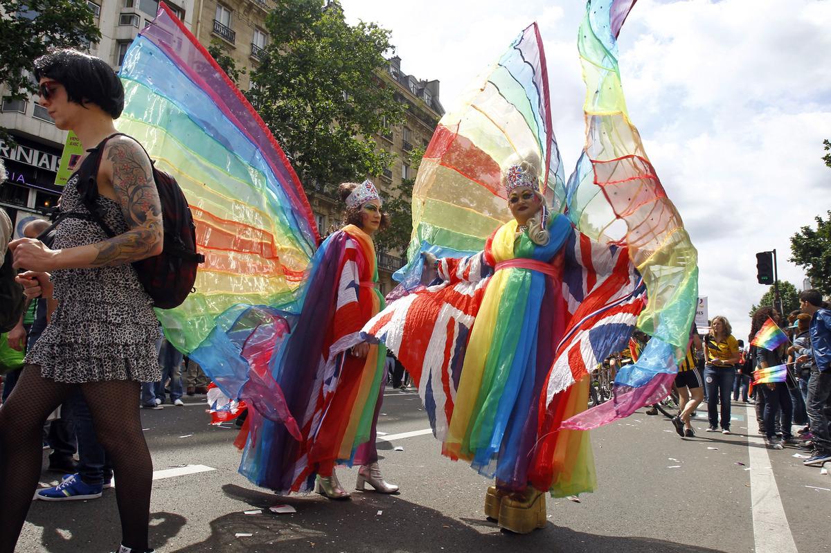 Participants in the annual Gay Pride march parade in a street of Paris, Saturday June 29, 2013.(AP Photo/Remy de la Mauvinier