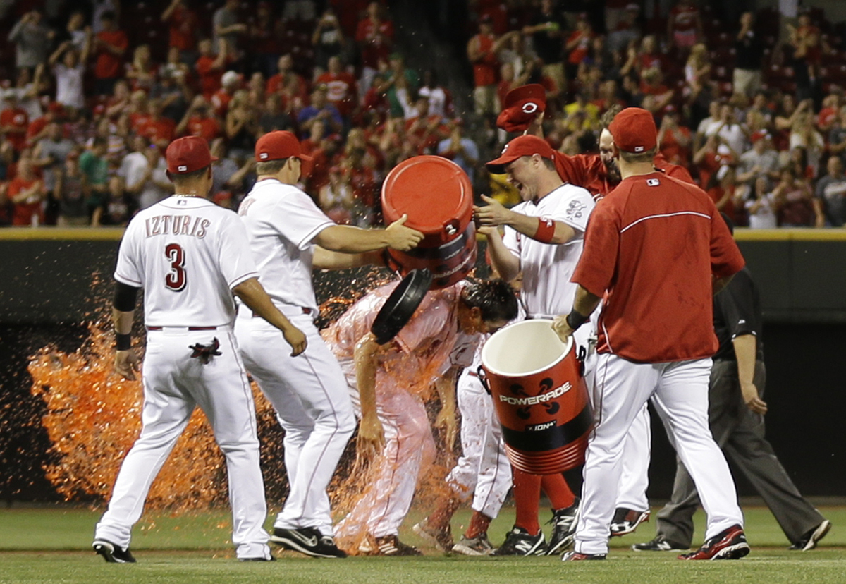 Cincinnati Reds starting pitcher Homer Bailey, center, is doused by his teammates after Bailey threw a no-hitter against the