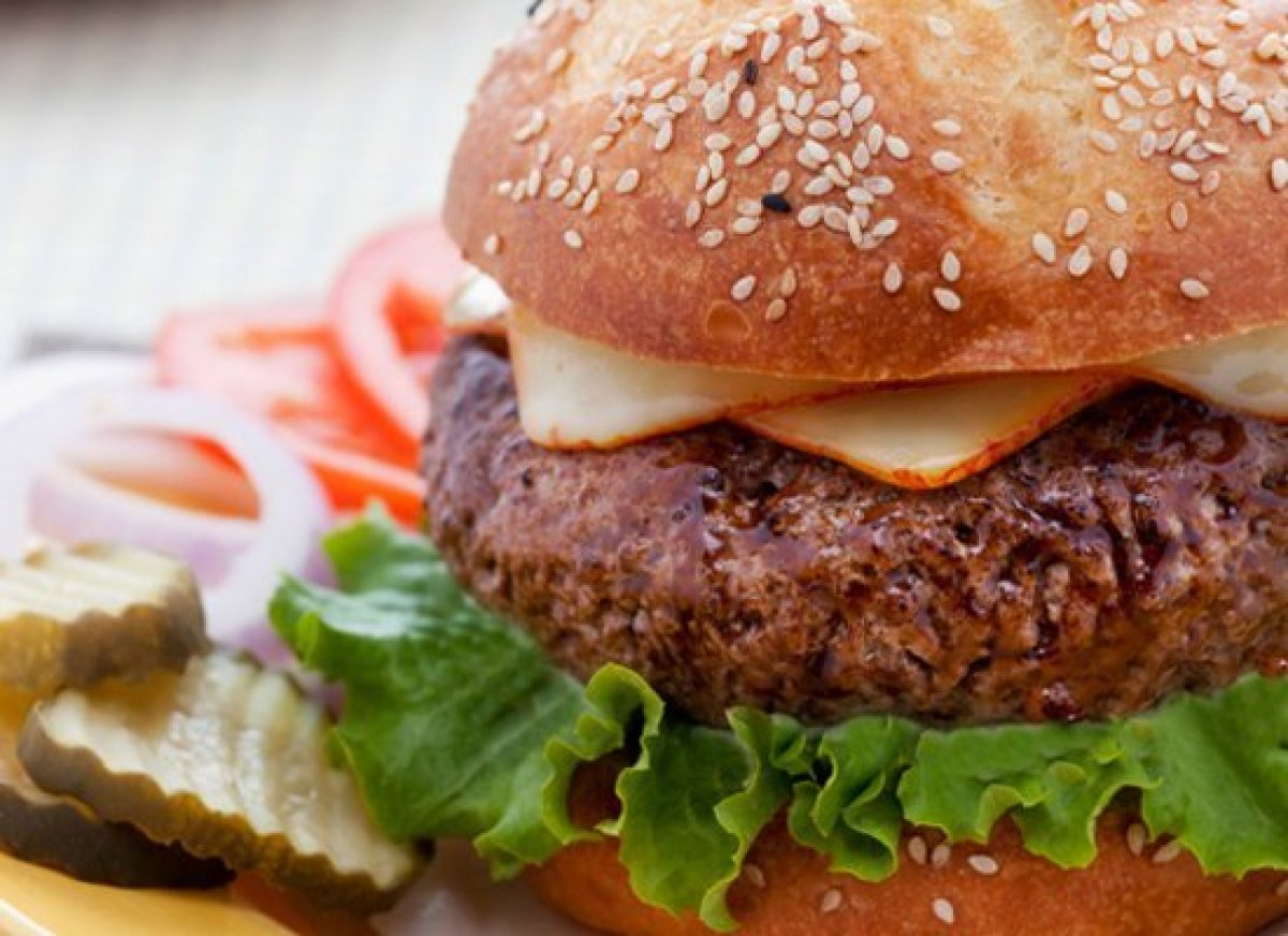 These rival the best steakhouse burgers -- find out the secret to making them tender, juicy and flavorful every time. <a href