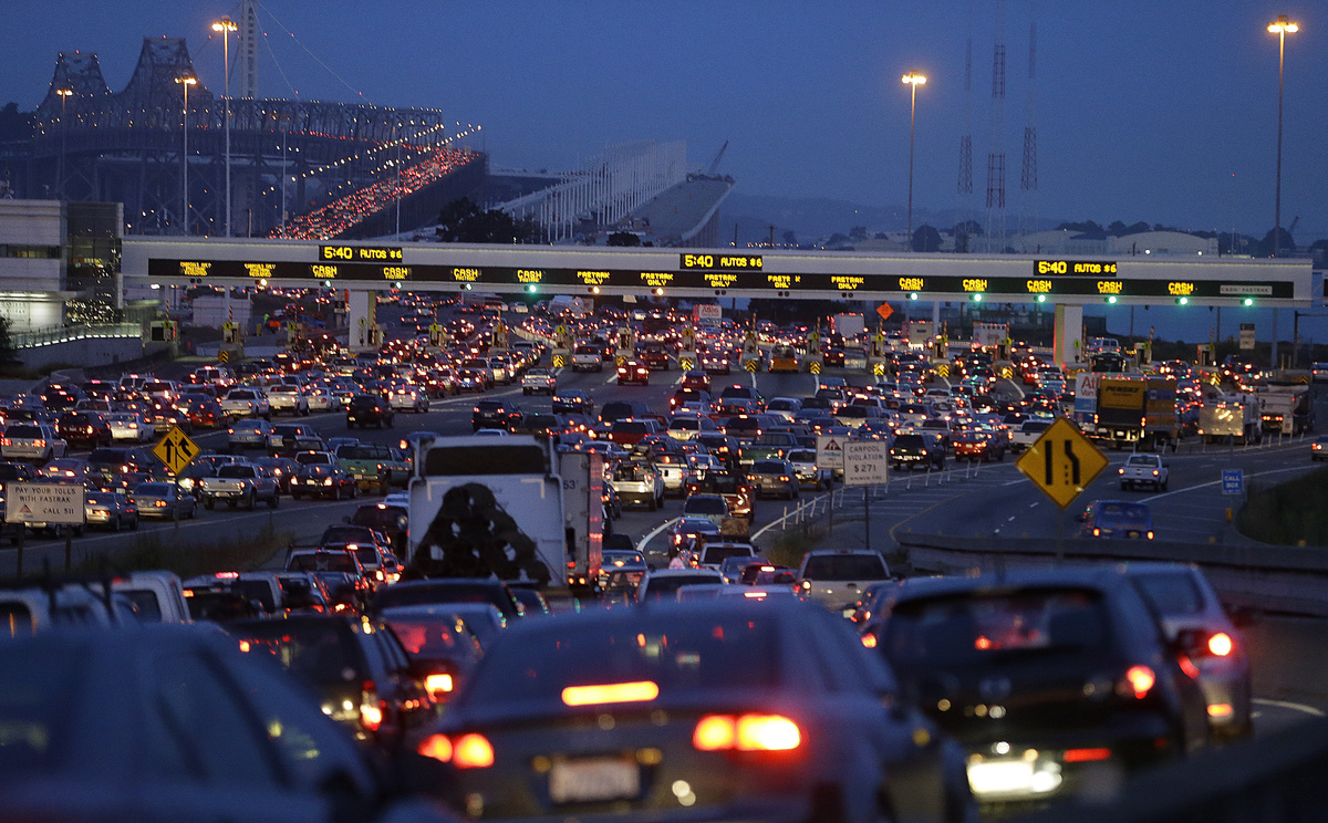 Commuters wait to pay their tolls on the San Francisco-Oakland Bay Bridge, Monday, July 1, 2013, in Oakland, Calif. Negotiati
