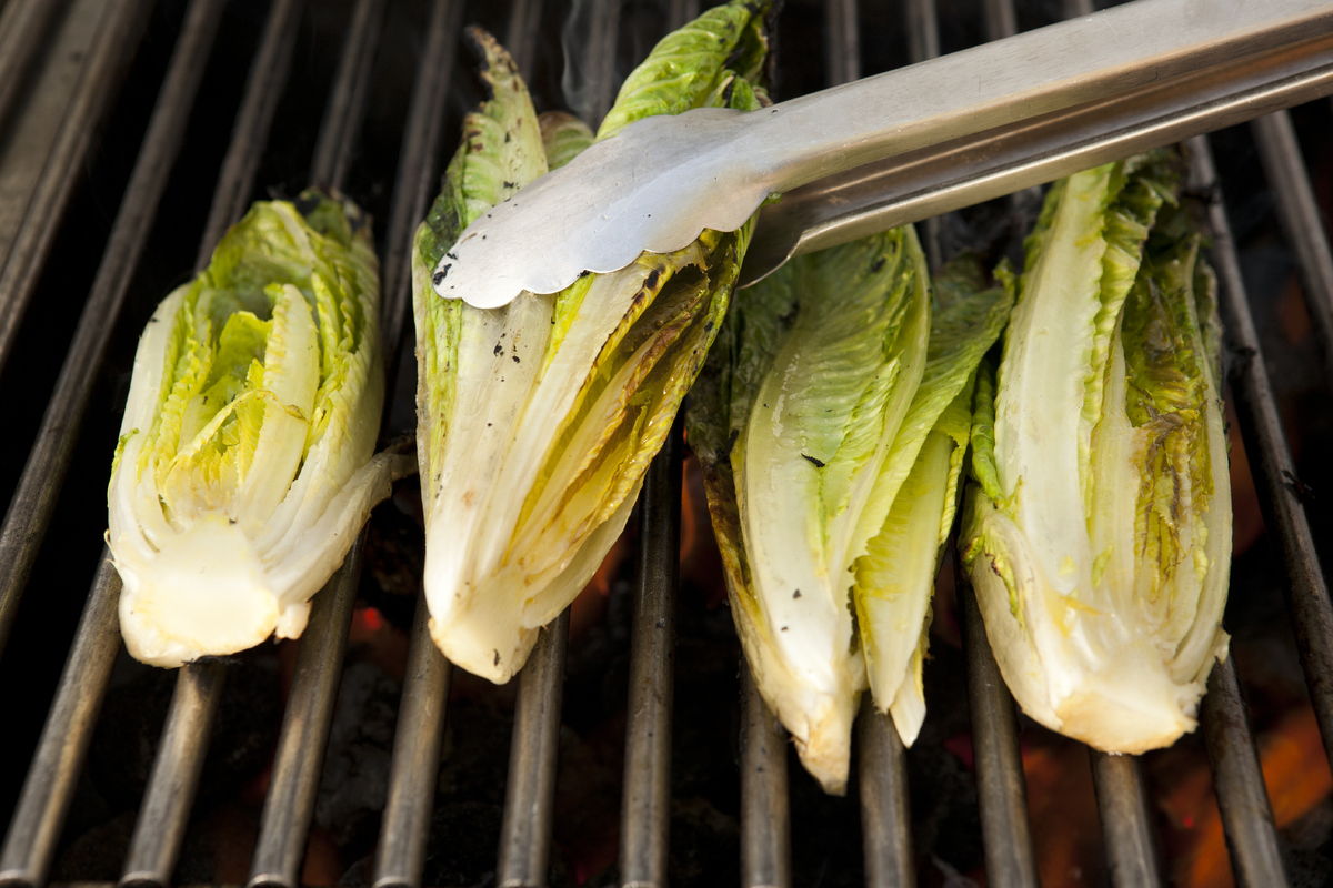 We typically think of salad as the cold counterpart to a warm, grilled meal, but turns out that lettuce can go right on the g