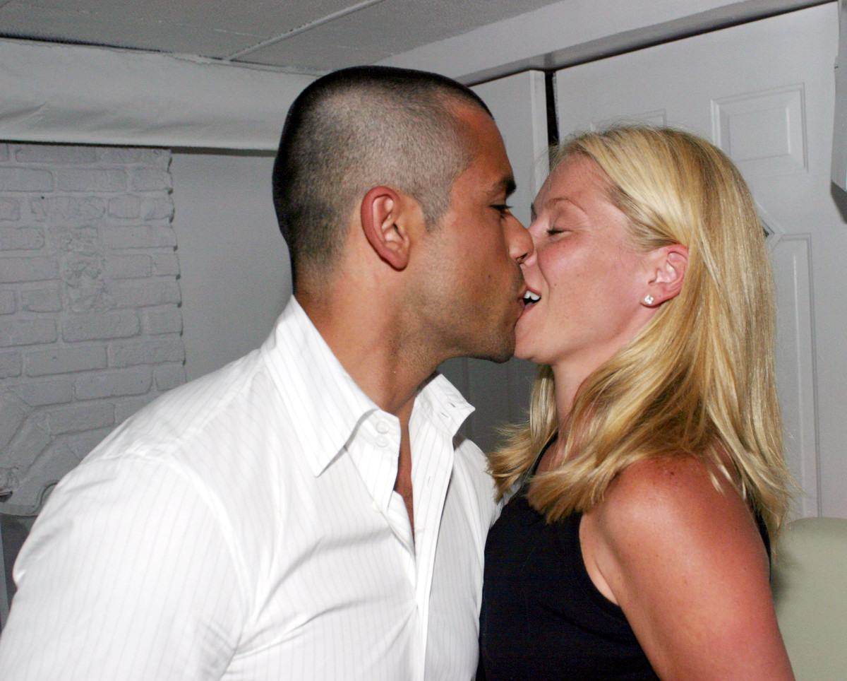 Mark Consuelos appears to be kissing Kelly Ripa's teeth in this photo, taken at a party in 2003. The couple has been <a href=