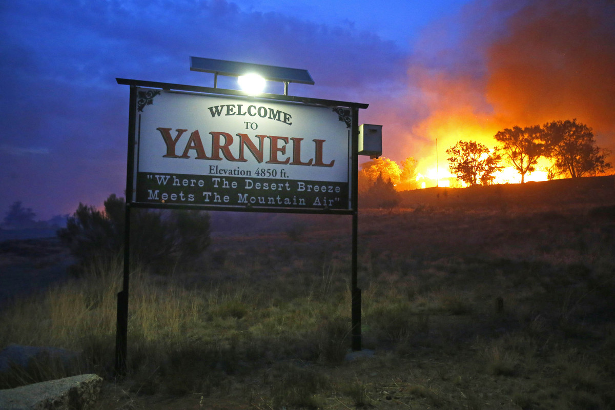 A wildfire burns homes in Yarnell, Ariz. on Sunday, June 30, 2013. An Arizona fire chief says the wildfire that killed 19 mem