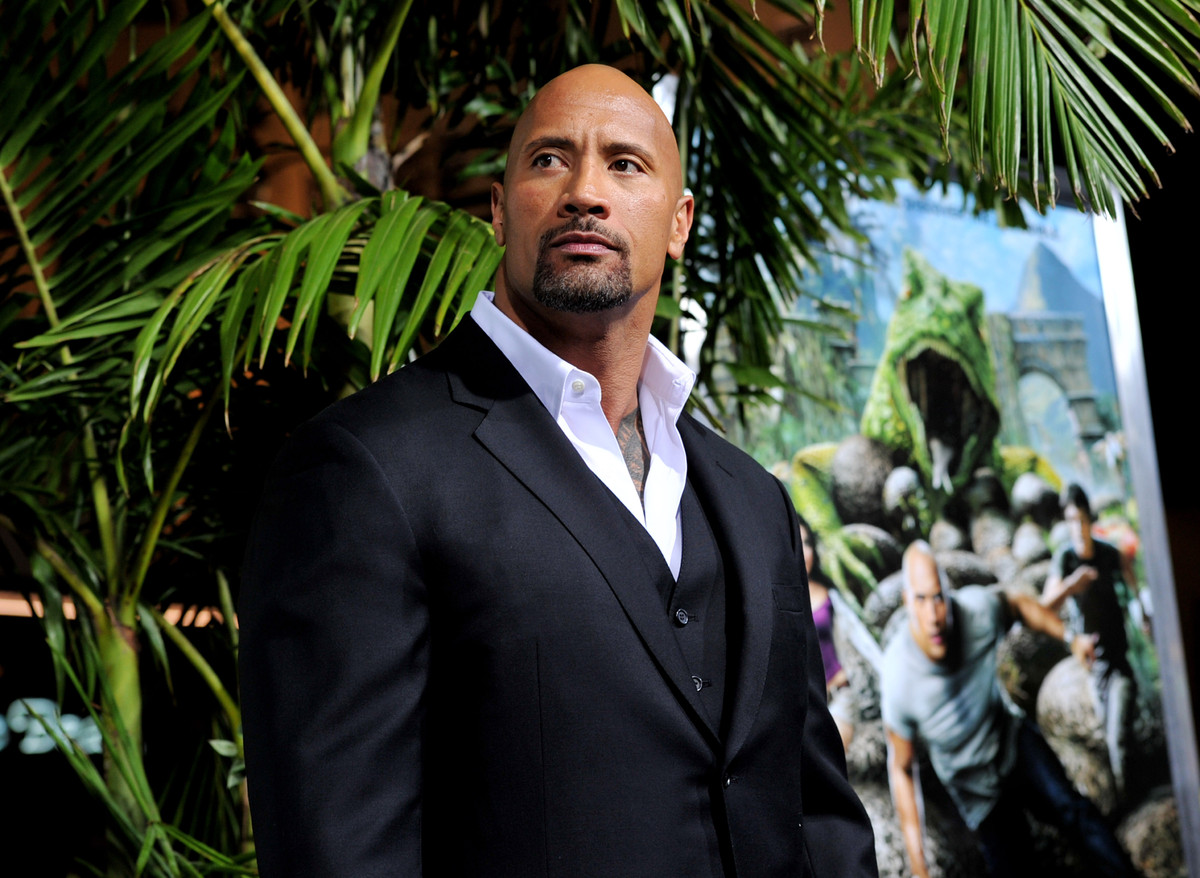 LOS ANGELES, CA - FEBRUARY 02:  Actor Dwayne Johnson arrives at the premiere of Warner Bros. Pictures' 'Journey 2: The Myster