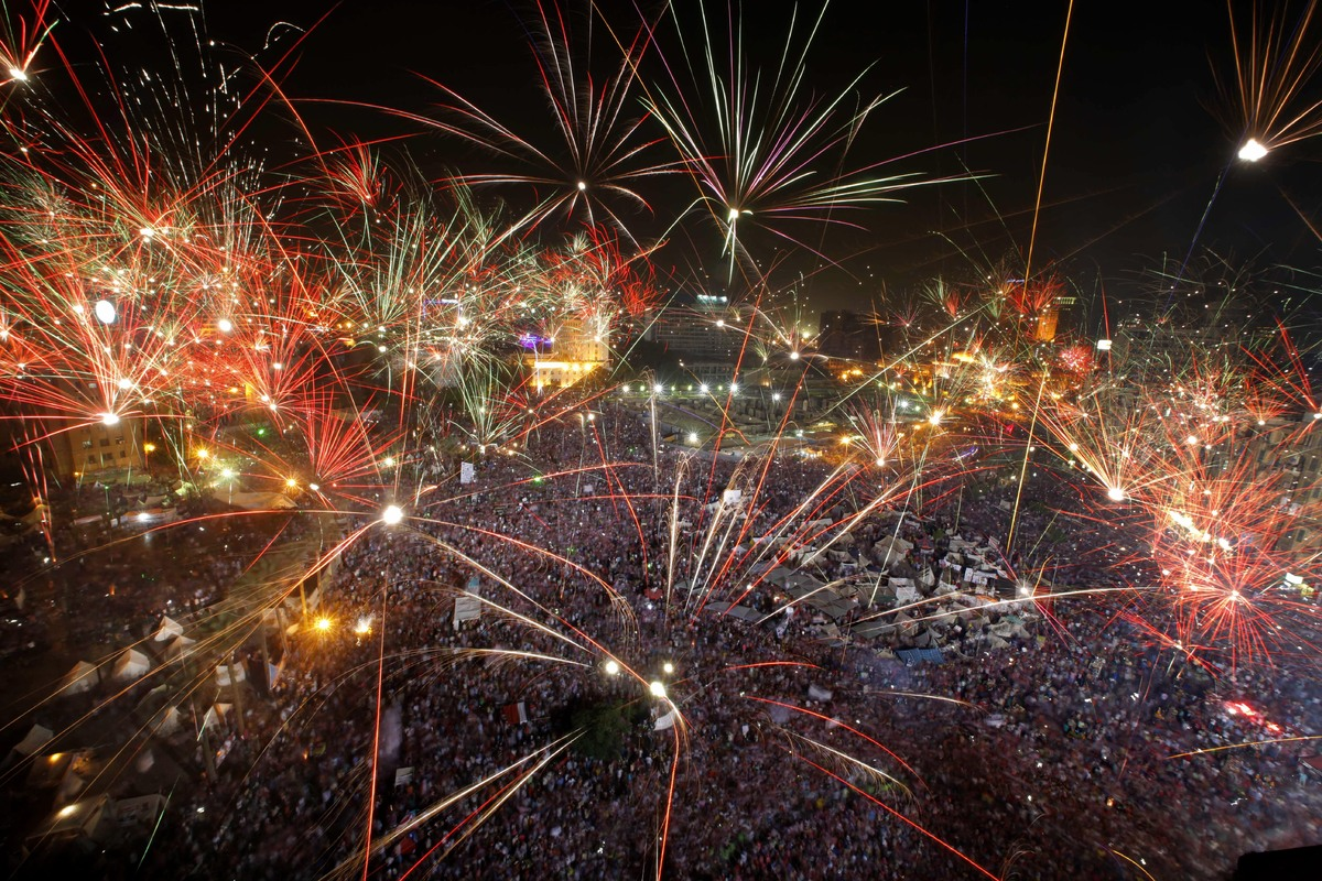 Fireworks light the sky opponents of Egypt's Islamist President Mohammed Morsi celebrate in Tahrir Square in Cairo, Egypt, We