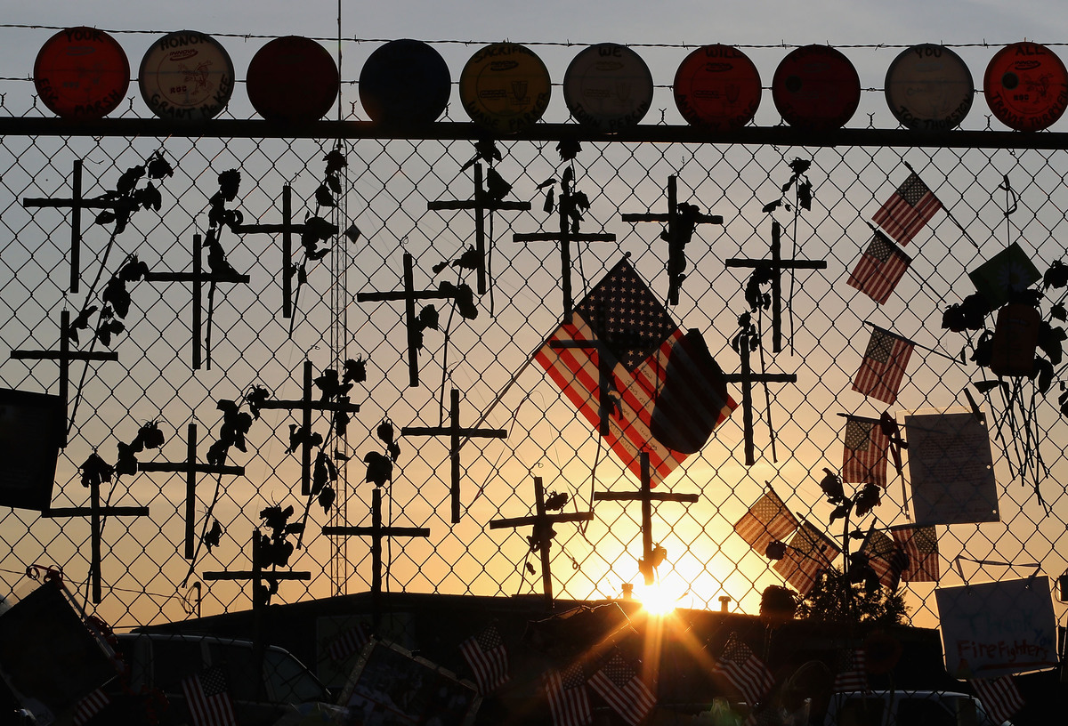 Nineteen crosses and American flags adorn the fence outside of Station 7 on July 3, 2013 in Prescott, Arizona. Nineteen firef