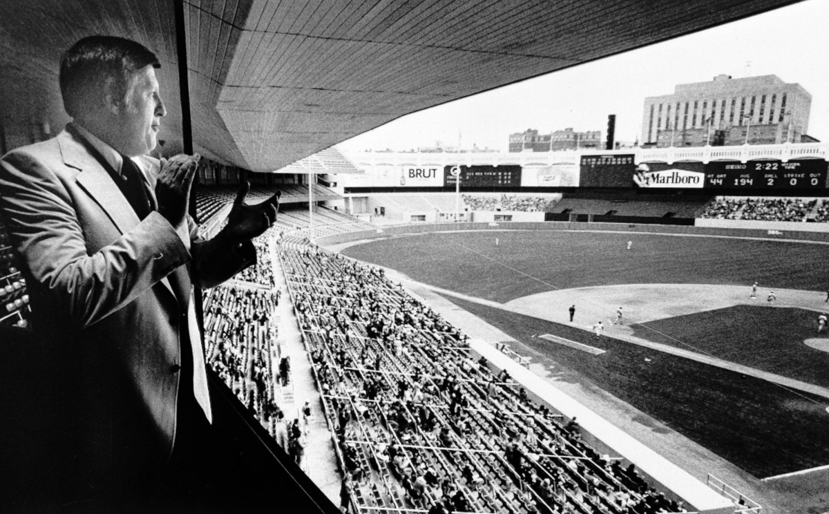 New York Yankees' owner George Steinbrenner applauds from his private box as his team scores some first inning runs at Yankee