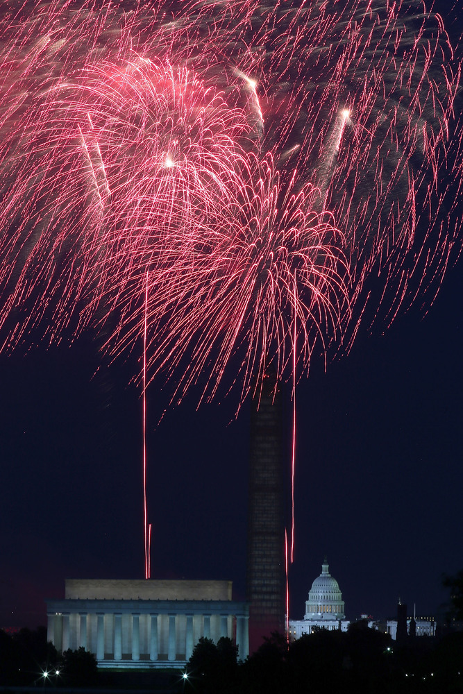 WASHINGTON, DC - JULY 04:  Fireworks light up the sky over the Lincoln Memorial, Washington Monument, and the U.S. Capitol on