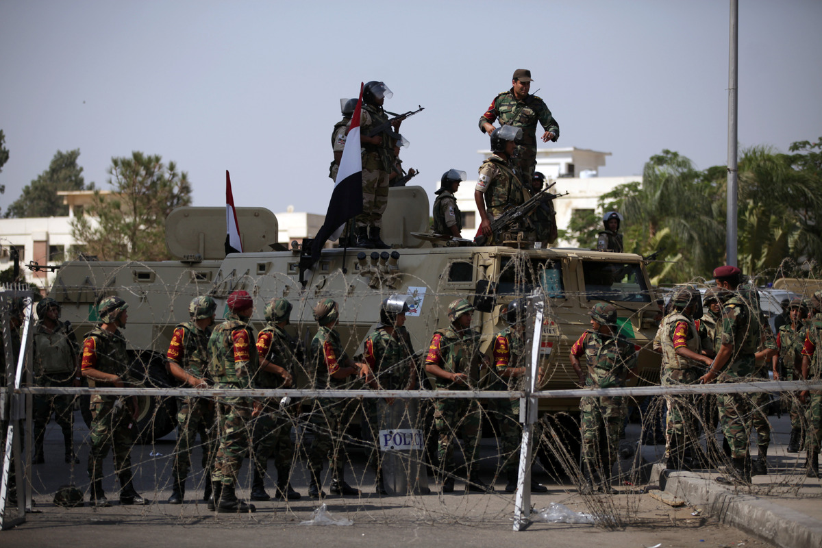 Egyptian soldiers stand guard outside the Republican Guard building in Cairo, Egypt, Friday, July 5, 2013. (AP Photo/Khalil H