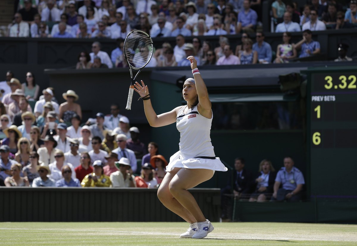 Marion Bartoli of France reacts as she wins the Women's singles final match against Sabine Lisicki of Germany at the All Engl
