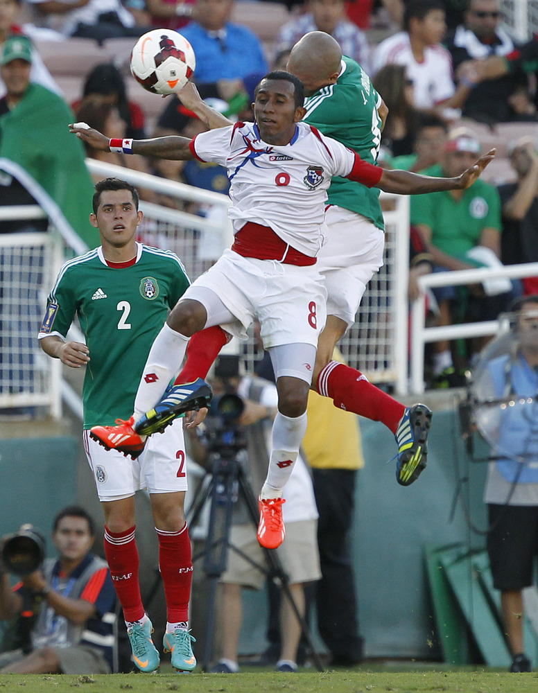 Panama midfielder Marcos Sanchez (8) keeps the ball away from Mexico forward Isaac Brizuela, right, and Mexico defender Israe
