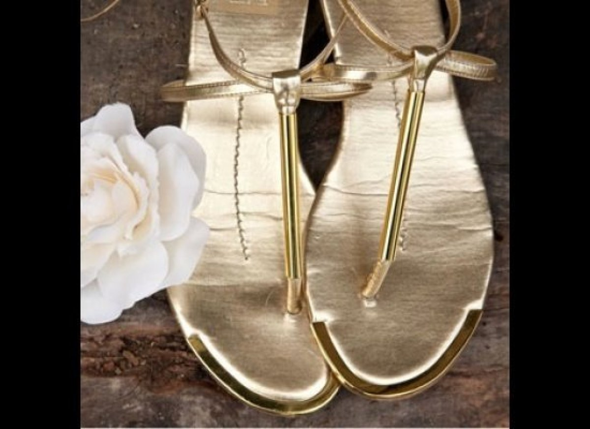 Want to glow like a goddess on your big day? Tote striking sandals with metallic accents like this gold DV by Dolce Vita pair