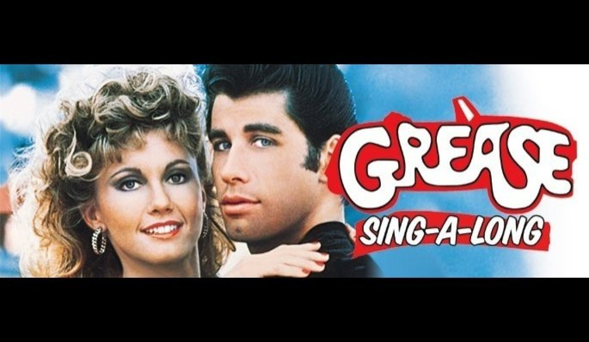 Experience a movie classic in a whole new way. This Saturday, July 13 at 7:30 PM, the Grease Sing-A-Long returns to the Holly