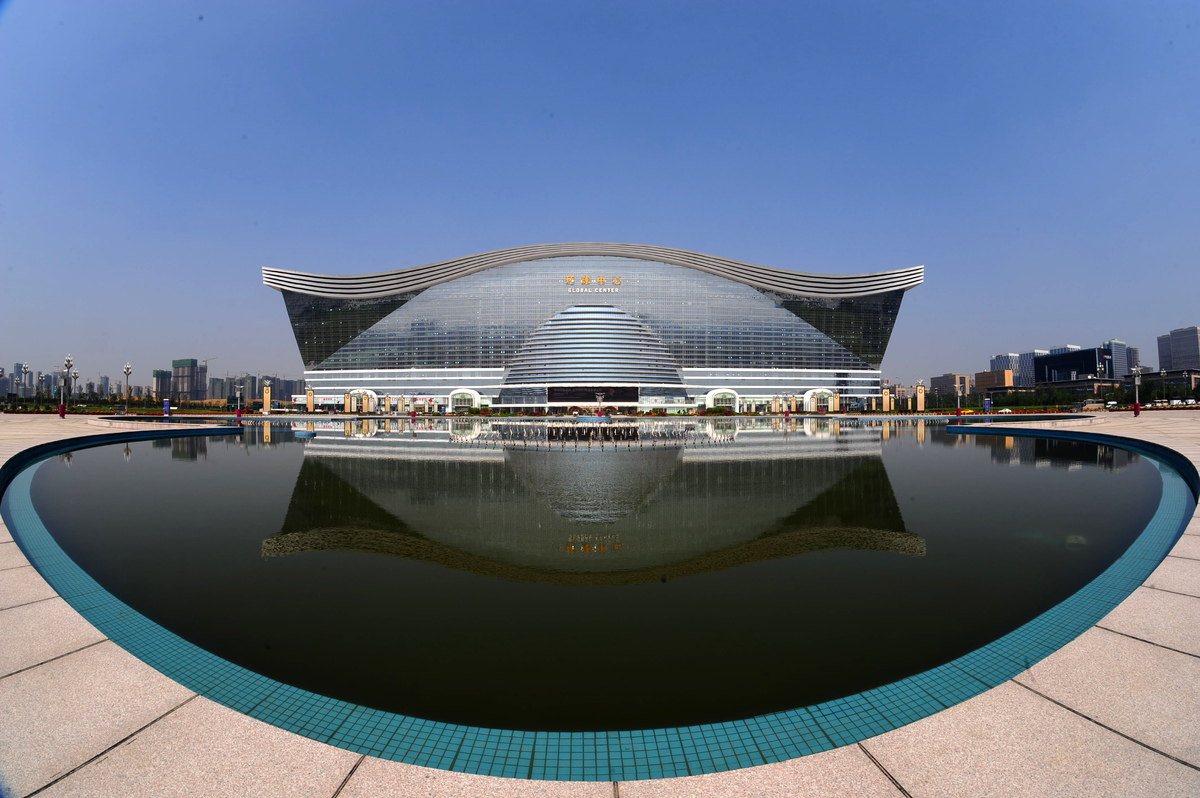 The 'New Century Global Centre' building is seen behind an artificial lake in Chengdu, in southwest China's Sichuan province