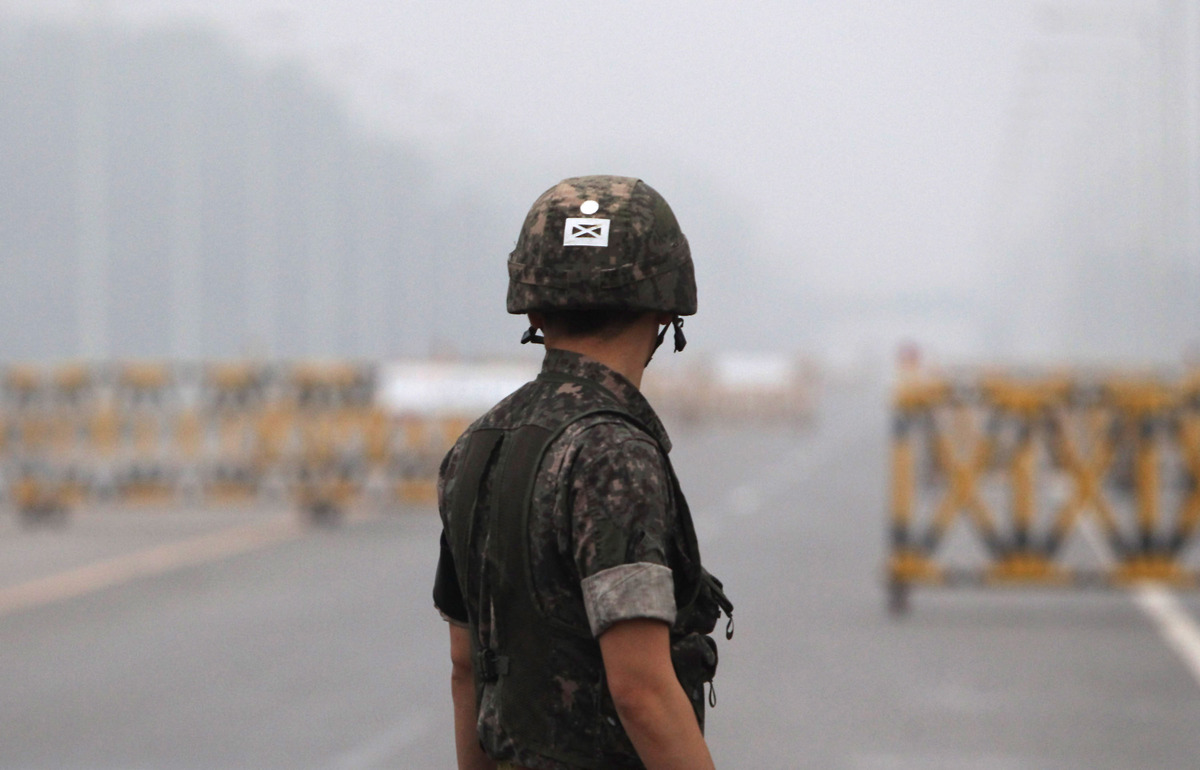 A South Korean soldier stands at a military check point connecting South and North Korea at the Unification Bridge on July 10
