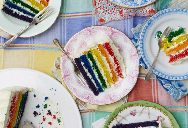 Though this dessert looks like a plain white, frosted cake, slicing into it reveals seven Roygbiv-colored layers that will un