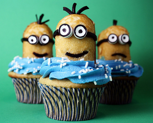 """<strong>Get the <a href=""""http://www.confessionsofacookbookqueen.com/2010/08/minions/"""" target=""""_blank"""">Minions Cupcakes recipe"""