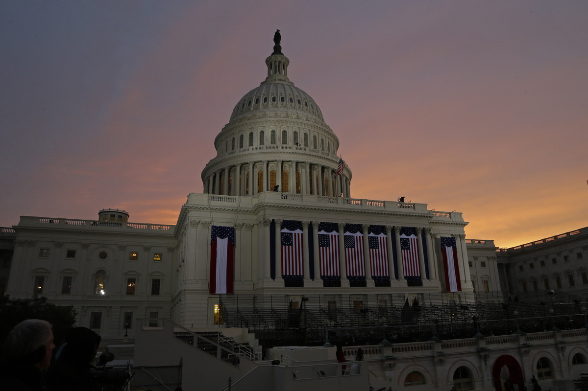 The sun rises behind the U.S. Capitol Dome early in the morning before the ceremonial swearing-in of President Barack Obama d