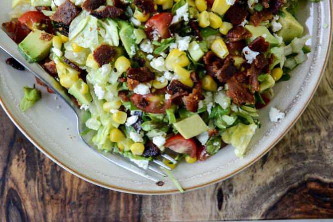 "<strong>Get the <a href=""http://www.howsweeteats.com/2013/05/blt-chopped-salad-with-corn-feta-avocado/"" target=""_blank"">BLT C"