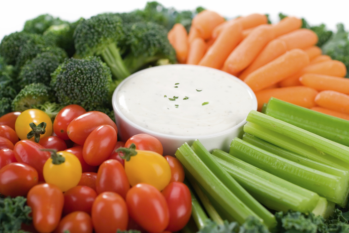 Veggies and dip make for a great go-to snack. Blatner suggests modifying a traditional Ranch dip, using Greek yogurt for an e